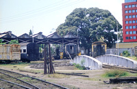 JMT30432 - Tanzania TR   at Dar es Salaam - 11-09-2005 - Turntable, with roundhouse filled with coaches  - John Tolson